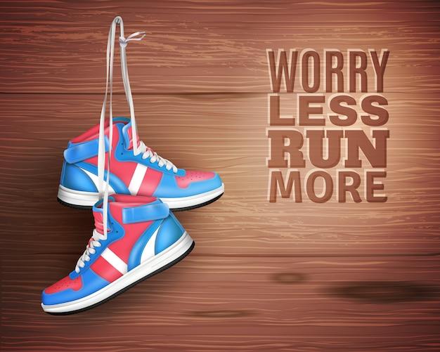 Par de calçados esportivos de couro no fundo de madeira