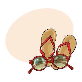 Par de chinelos e óculos de sol redondos na moda, férias na praia