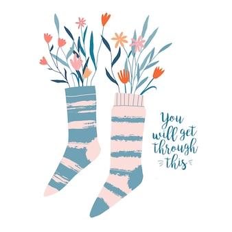 Par de meias, meias cheias de galhos e flores silvestres