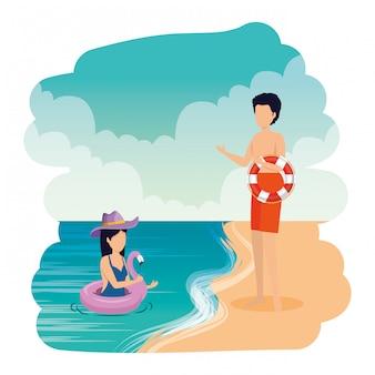 Par jovem, com, flutuadores, praia