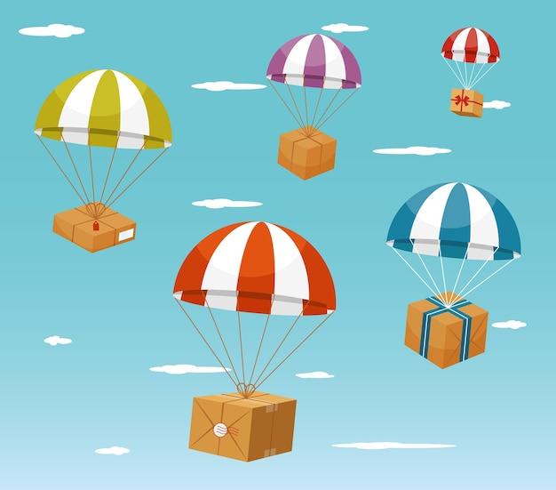 Pára-quedas colorido carregando caixas de presente no fundo do céu azul claro.