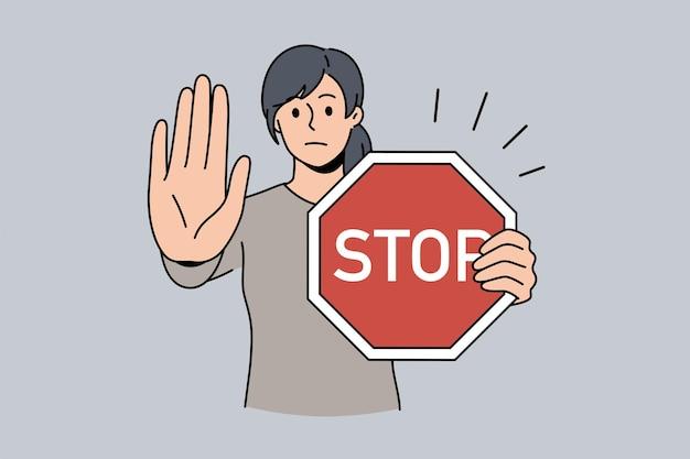 Pare o conceito de sinal e rejeição. personagem de desenho animado jovem séria em pé com uma placa vermelha parada nas mãos e mostrando a palma da mão com uma ilustração do vetor de emoção recusada