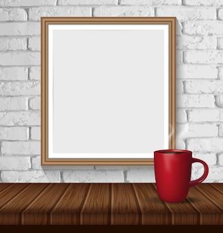 Parede de tijolo branca com quadro e a xícara de café vazios de madeira.