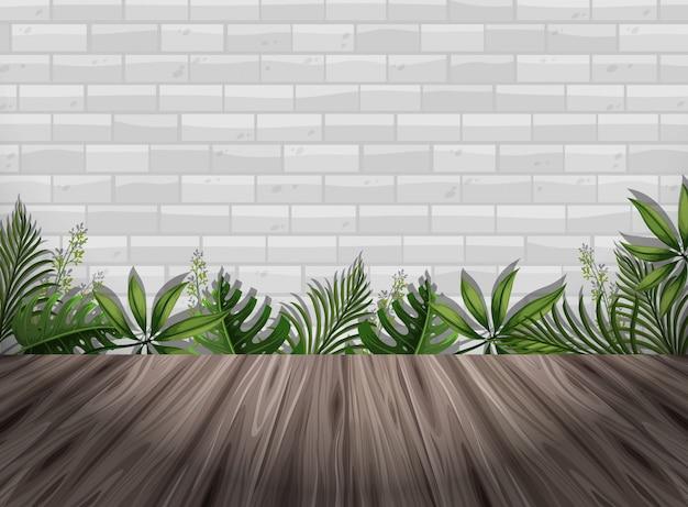 Parede de tijolo branco e piso de madeira