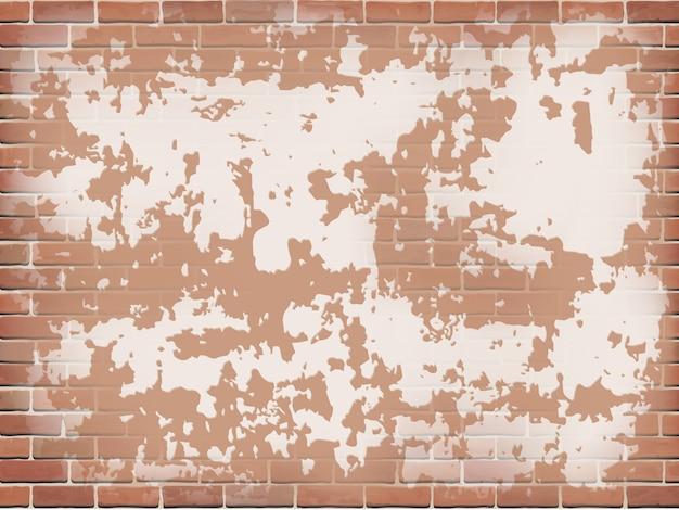 Parede de tijolo vermelho velha com gesso descascado.