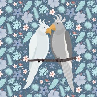 Pares bonitos dos papagaios cercados por flores.