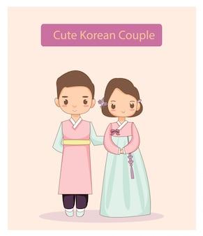 Pares coreanos bonitos no vestido tradicional.