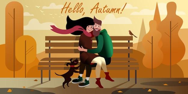 Pares novos que abraçam em um banco no parque da cidade do outono. cena de rua da cidade.