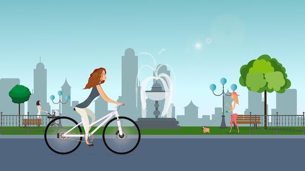 Parque com garotas, uma garota de bicicleta, uma garota com um carrinho, uma garota com um cachorro.