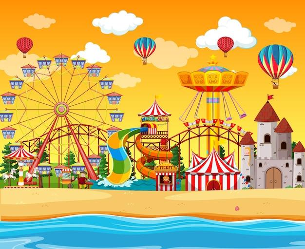 Parque de diversões com cena à beira-mar durante o dia e balões no céu
