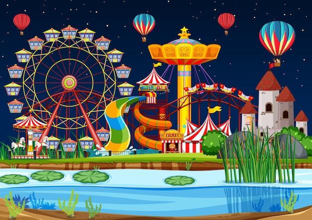 Parque de diversões com cena de pântano à noite com balões