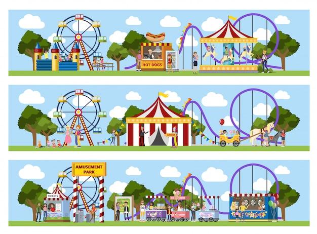 Parque de diversões com tenda de circo, carrosséis e palhaços.