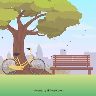 Parque de fundo com uma árvore e uma bicicleta