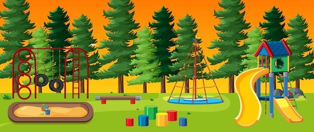 Parque infantil no parque com céu claro vermelho e amarelo e muitos pinheiros no estilo cartoon