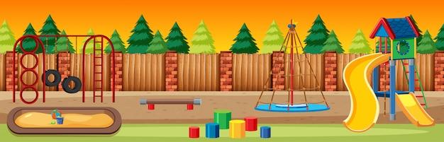 Parque infantil no parque com céu de luz vermelha e amarela e muitos pinheiros estilo cartoon