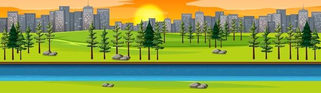 Parque natural da cidade com paisagem à beira do rio e cena do pôr do sol