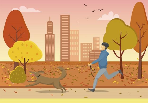 Parque outono e cara correndo com cachorro na coleira