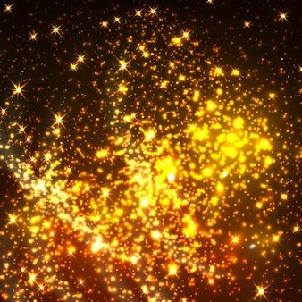 Partículas de luz cintilantes de ouro brilhante. estrelas cintilantes de ouro com fundo transparente. a luz cintilante faisca e cintila em spray de brilho luminoso
