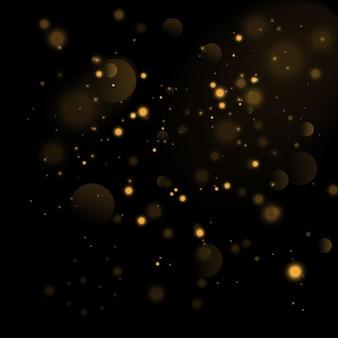 Partículas de ouro. círculos de bokeh amarelo brilhante, poeira dourada cintilante, decoração luxuosa de fundo dourado