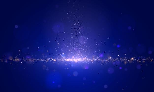 Partículas de poeira mágica de brilho e espumante com efeito bokeh.