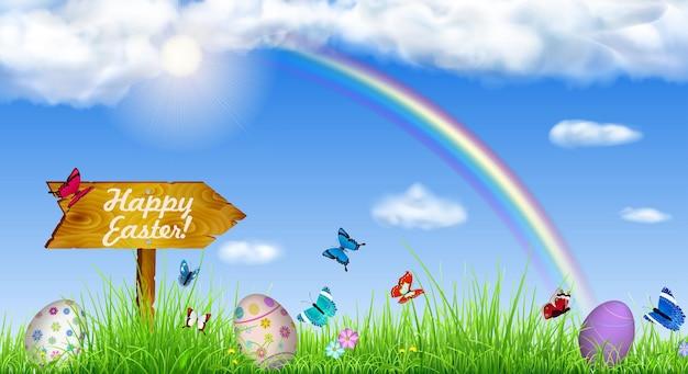 Páscoa com céu, sol, grama, arco-íris, ovos de páscoa, borboletas, flores e ponteiro de madeira