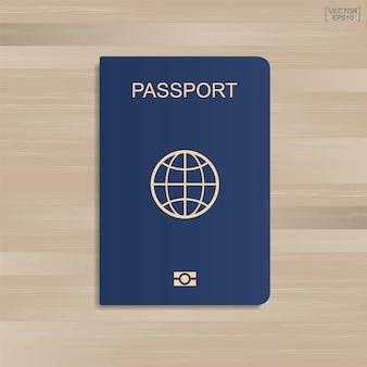 Passaporte azul sobre fundo de madeira. ilustração vetorial.