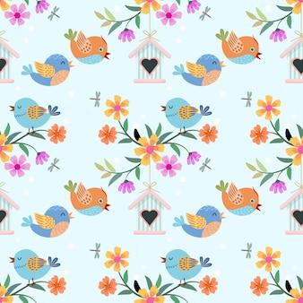 Pássaro bonito dos desenhos animados e padrão de flores.