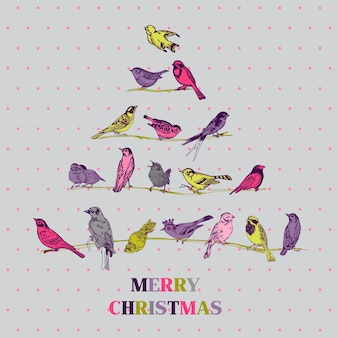 Pássaros de cartão de natal retrô na árvore de natal