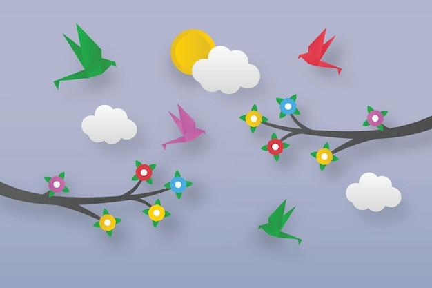 Pássaros de origami em ramos de flores