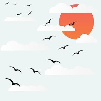 Pássaros voam ao pôr do sol