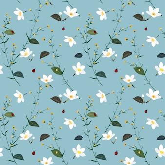 Pastel padrão sem emenda com flor selvagem no fundo azul suave