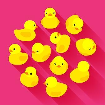 Pato de borracha amarelo contra o fundo rosa