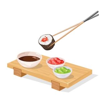 Pauzinhos segurando sushi tekkamaki rolar sobre molhos