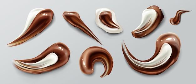 Pedaços de chocolate marrom-branco líquido manchas em molho de ganache ou xarope e manchas derretidas isoladas
