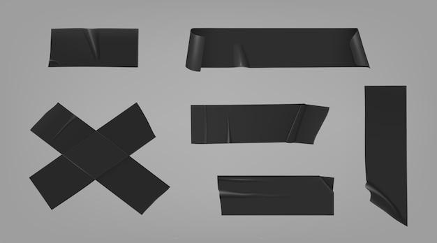 Pedaços de fita adesiva preta