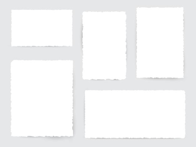 Pedaços de papel rasgado branco em branco