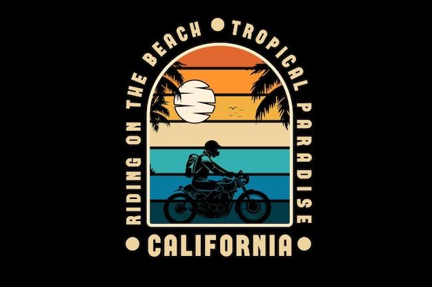 Pedalando na praia paraíso tropical da califórnia cor laranja amarelo e verde