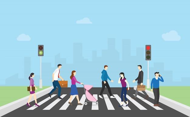 Pedestre atravessar a rua com pessoas da equipe e semáforo e cidade