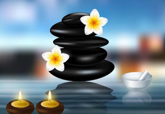 Pedras do zen do conceito dos termas e flores do frangipani