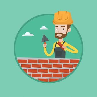 Pedreiro trabalhando com espátula e tijolo.