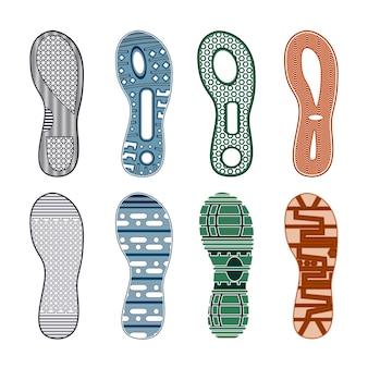 Pegadas de tênis esportivos conjunto colorido de diferentes padrões em fundo branco isolado