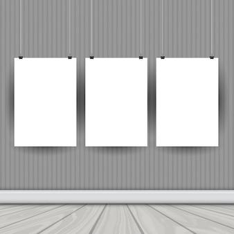 Pendurar quadros de imagem em branco em um quarto