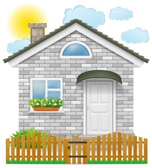 Pequena casa de campo com uma cerca de madeira