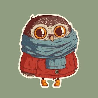 Pequena coruja em roupas quentes