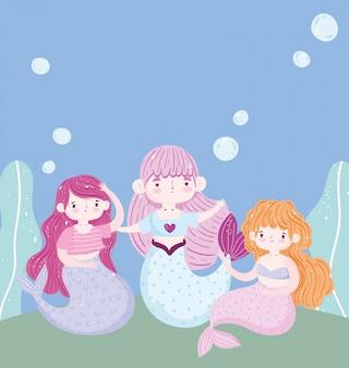 Pequenas sereias fofas debaixo d'água