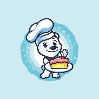 Pequeno chef do urso polar segurando o desenho da mascote do pedaço de bolo