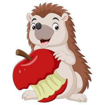 Pequeno ouriço de desenho animado segurando uma maçã vermelha mordida