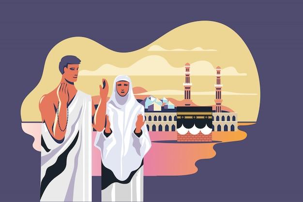 Peregrinos muçulmanos masculinos e femininos rezando perto de kaaba