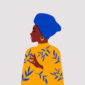 Perfil lateral de mulher africana usando um envoltório de cabeça chamado gele.