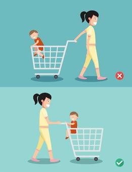 Perigo e segurança para criança sente-se no carrinho de compras, vetor